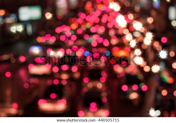 blurred backgrounds of bokeh from car light on the traffic road .