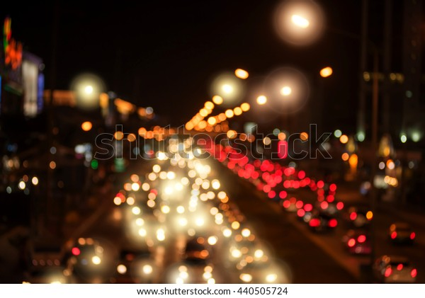blurred backgrounds of bokeh from car light on the traffic road