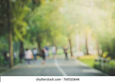 blurred backgrounds of people exercise and running at park outdoor