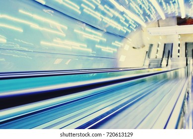 Blurred backround of moving futuristic escalator. Blurred image.Post process in vintage style