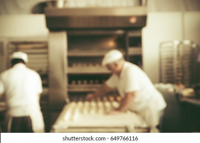 Blurred bakery shop in wholesale store with baking machine, oven, conveyor, production line, mixer and cooling plant. Modern food processing plant factory. Food industry backgroud. Vintage tone.