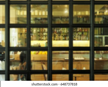Blurred of bar counter and bottles, bar and bistro front view.