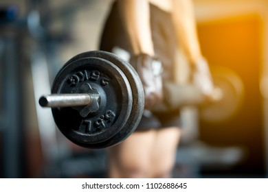 Blurred barbell plate for exercise in fitness gym