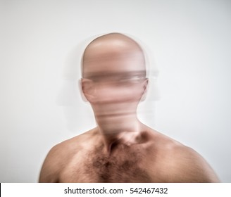 Blurred bare-chested man suffering from mental disorder and schizophrenia