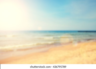 Blurred beach with lens flare effect, nature background.