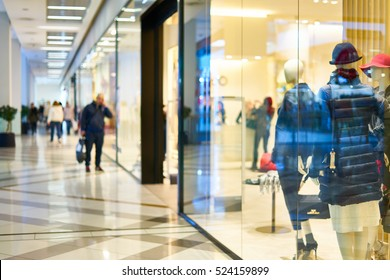 Blurred beautiful lobby at the malls. Blurred showcases fashion boutique with clothes. Blurred bokeh basic background for design