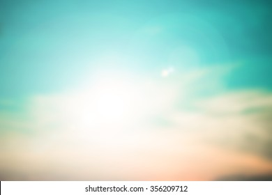 blurred beautiful natural teal sky landscape background with ray flare light