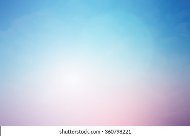 blurred beautiful pastel colorful of natural landscape background with ray lens flare light concept.