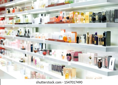 Blurred beautiful shop in shopping malls. Big sales on Black Friday for Christmas. The large perfumery shop of elite perfumery and cosmetics is washed out. Rack with shelves in a large drogeria