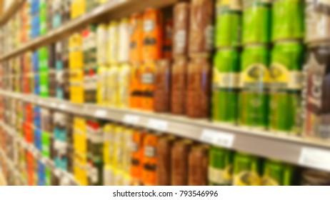 Blurred beer selection on supermarket shelves