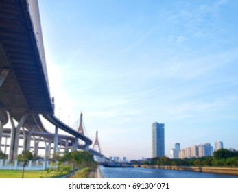 Blurred Bhumibol bridge with skyscraper and floodgate, Samut Prakarn,Thailand
