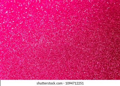 Blurred blaze pink glitter Christmas texture backdrop.  Red purple abstract photo of bokeh lights. Hot Plastic Pink color trends 2019.