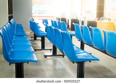 Blurred blue chair  waiting zone in hospital.