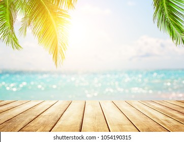 Blurred blue sky with bokeh light and old wooden table background