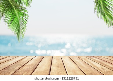 Blurred blue sky and sea with bokeh light and white wooden table background
