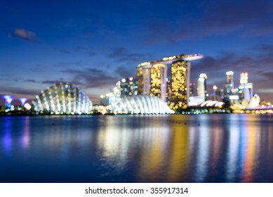Blurred bokeh abstract motion of Singapore Skylines, Downtown and Financial District buildings reflection along the Singapore River at Blue Hour. Colorful bokeh lights  background of Modern City
