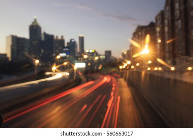 Blurred bokeh background of a city with sky scrapers and busy highway