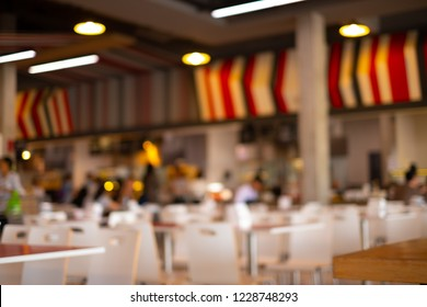 Blurred bokeh background of restaurant with people.