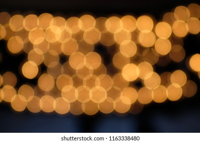 Blurred bokeh background with round yellow lights
