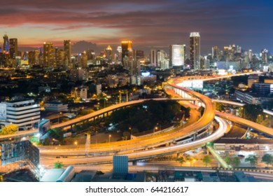 Blurred bokeh city downtown background and highway interchanged aerial view, abstract background