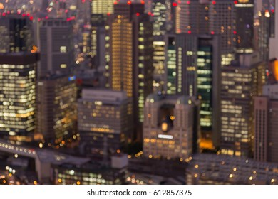 Blurred bokeh light office building aerial view close up, abstract background