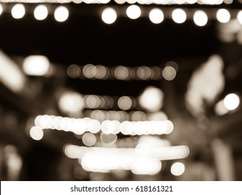 Blurred bokeh light on street in the night time, vintage tone