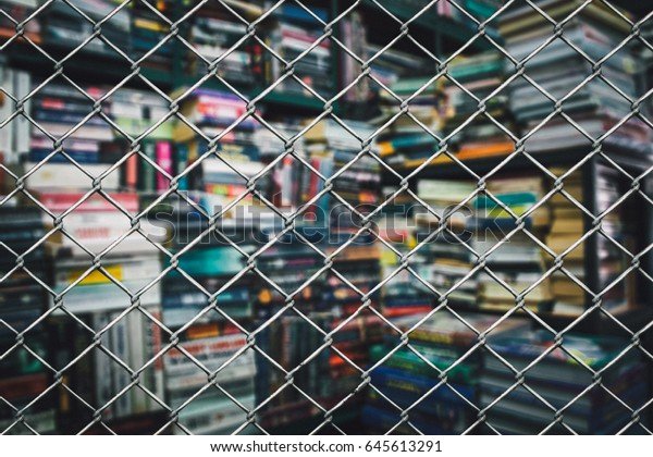 Blurred book in cage