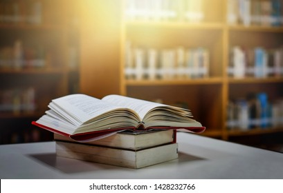 The blurred book that is bewitched with magic, the magic light in the dark, with the bright light shining down as the power to search for knowledge. For research and use as a blurred background