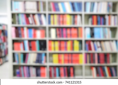 Blurred of books in the bookshelves at the public library. Education concept.