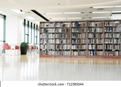 Blurred books in library for background.