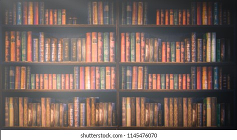 blurred bookshelf Many old books in a book shop or library.