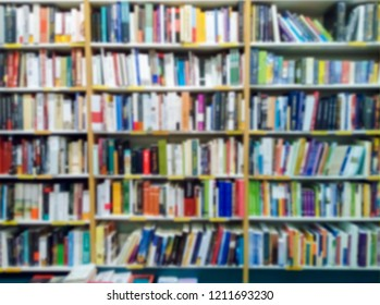 Blurred of bookshelves in the public library. Blurred effect Background