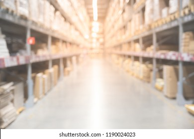 Blurred boxes on rows of shelves in warm light warehouse background.  Using for Mock up template for craft display of your design,Banner for advertise of product.