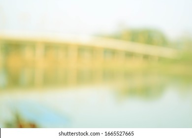 Blurred bridge over the beautiful river in the evening