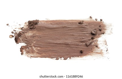 Blurred brown eyebrow pencil. A stroke of brown acrylic paint is isolated on a white background