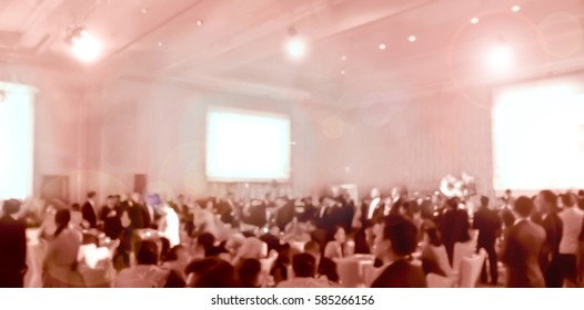 blurred brown people  eating and talking in hotel ballroom party
