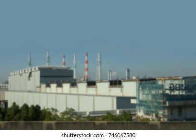 Blurred Building and factory chimney in an industrial plant.