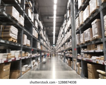 Blurred business background, Lt is a warehouse of a large-scale shopping center, Rows of shelves with boxes.