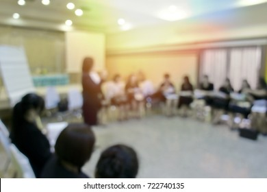 Blurred business or education people working on team work in conference room with personal or laptop computer debate and discussion