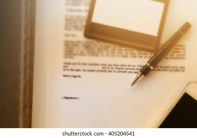 Blurred business letter document with pen and blank area for text signature, job well done, admire letter