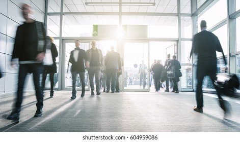blurred business people at a airport