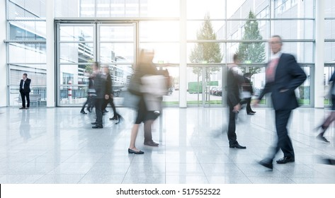 Blurred business people at a corridor