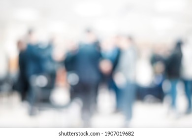 Blurred business people meeting in office interior with space for business brainstorming background design.