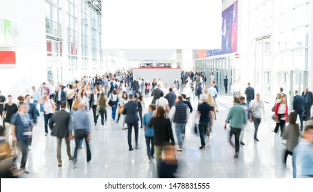 blurred business people in a modern corridor