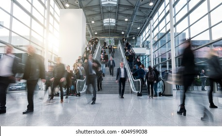 blurred business people in a modern hall