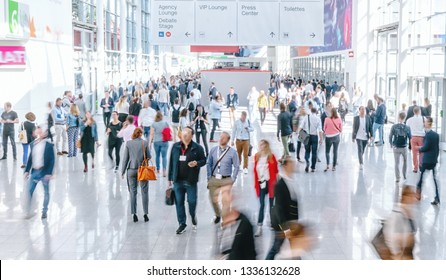 blurred business people at a trade fair
