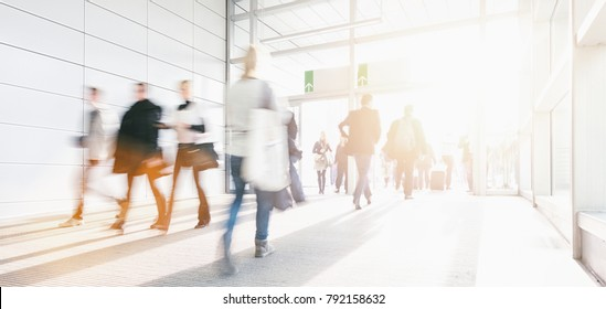 Blurred business people at a trade show