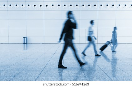 blurred business people using a smartphone