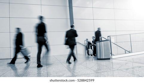 Blurred business people walking, germany