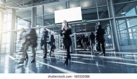 blurred business people walking in a modern hall